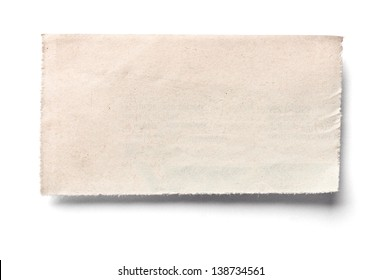 close up of an old newspaper piece of paper on white background