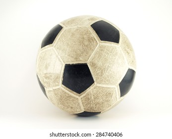 close up old rubber soccer ball isolated on white background, sport equipment for outdoor fitness or beach soccer