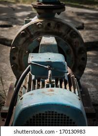close up old rust water pump under sunlight