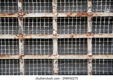 Close up of an old, rusted, metal grate