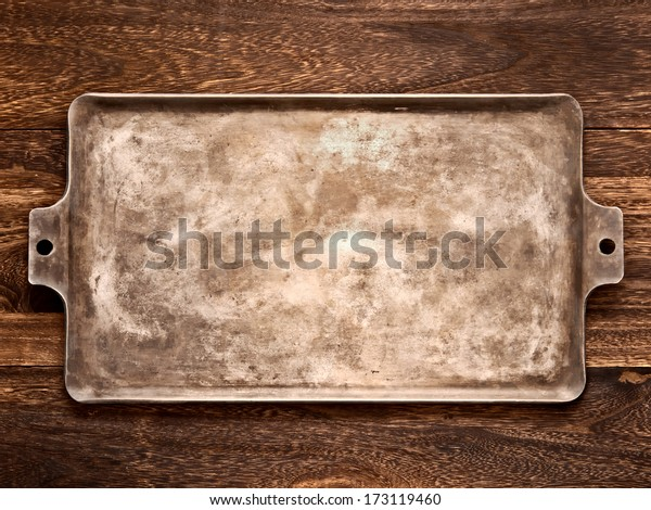 close up of an old rustic baking tray