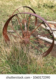 Close up of Old Rustic Wagon Wheels abandoned in country paddock