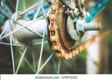Close up of old rusty chain from the bicycle on background nature ,Bicycle's detail view of wheel with old chain, sprocket,dirty chain (Vintage tone)