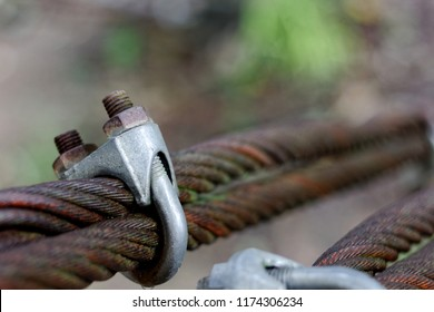 Close up old and rusty weathered wire rope clip or U Bolt