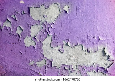 Close up of old stucco cracks on the wall. Weathered paint cracks on plaster. Cracked wall background. Abstract Web Banner