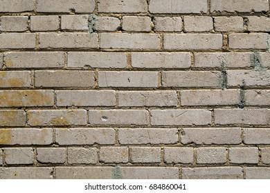 Close Up of an Old Tan Exterior Brick Wall