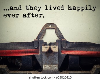 Close up of old typewriter covered with dust with and they lived happily ever after text