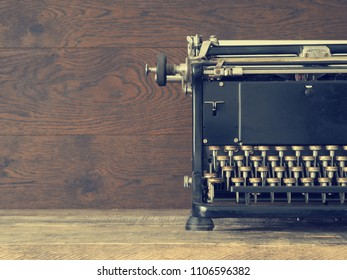 Close up of an old typewriter on a wooden table with space for text