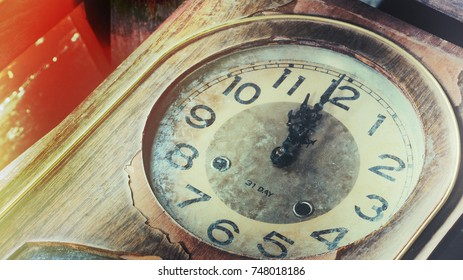 Close up of an old vintage clock face with clock hands, number on grunge clock face. Old clock for background.