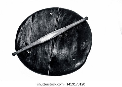 Close up of old vintage wooden rolling pin and circular board isolated on white used to make Phulka/chapati/roti.