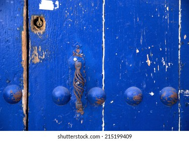 Close up from an old weathered blue door. The photo was taken in Seville in August 2014.