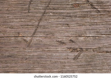 Close up of old weathered wooden planks with cracks and scratches as texture. Abstract natural background