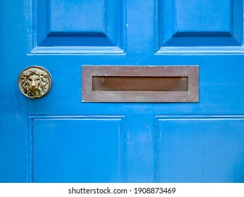 Close up of an old wooden blue door