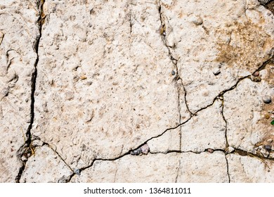 Close up of old worn cracked concrete rough surface. Abstract texture background
