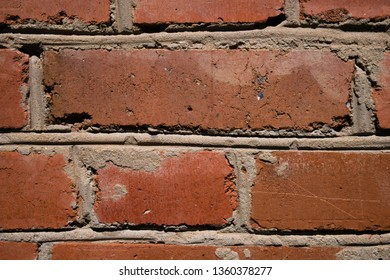 Close up of old worn weathered grunge red brick wall. Abstract texture background