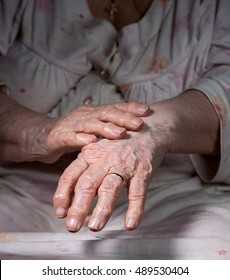Close up of old wrinkled woman's hands