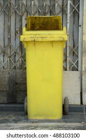 close up old yellow plastic bin