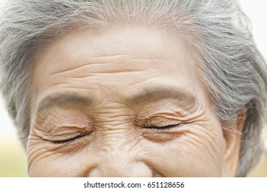 Close up of older Chinese woman's eyes