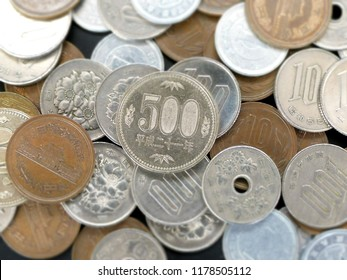 close up on 500 coins and other kind coins of Japanese Yen