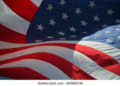 Close Up on American Flag Stars and Stripes Waving in the Afternoon Sun