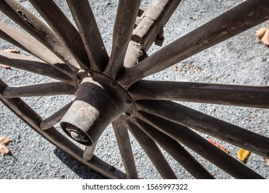 Close up on an antique old cartwheel under the sun