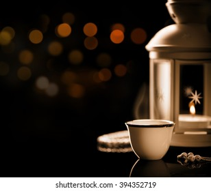 Close up on an Arabian coffee with Lantern and rosary.