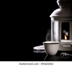 Close up on an Arabian coffee with Lantern and rosary