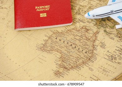 Close up on Australia map with passport and toy aircraft. Travel concept. Australia is a country comprising the mainland of the Australian continent, Tasmania island and numerous smaller islands.