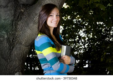 Close up on a Beautiful Teenager with Leaves in the Background