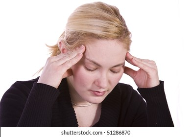 Close up on a Beautiful Woman with a Headache Rubbing her Temples
