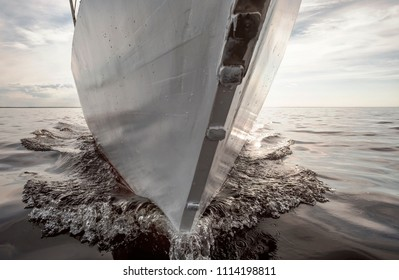 Close up on the bow of a sailing yacht from the ocean side