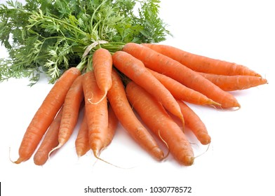 close on bunch of fresh carrots isolated on white background