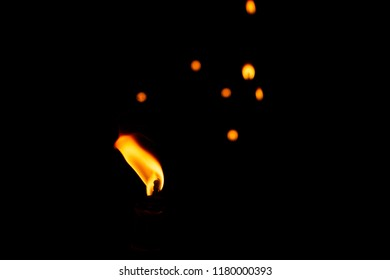 close up on candle fire on candles background, cemetery