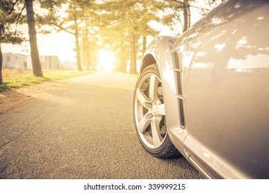 Close up on a car tyre while drifting on a street. Sport car driving fast on the street