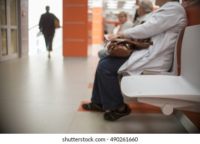 close up on Chairs for patients and visitors in hospital, defocused people