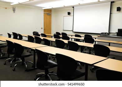 close up on classroom, seat, table and projector screen