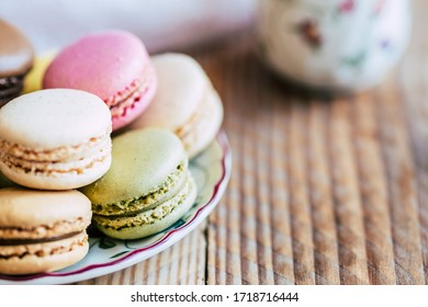 Close up on colorful macarons in a cup