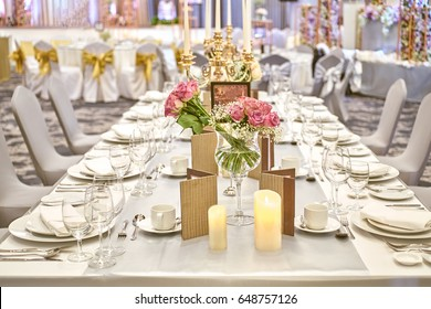 Close up on the desk of elegant white decoration in hotel present for wedding party. Image selective focus on the desk.