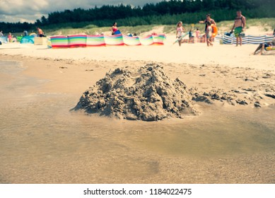 close up on destroyed sand castle on the beach