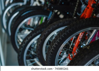 Close up on detail of modern bicycles. Sports shop, factory warehouse, repair station workshop abstract mobility technology background.