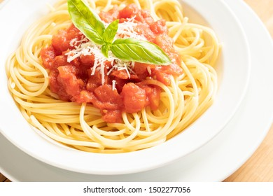 close up on dish with spaghetti tomato and basil