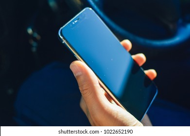 Close up on driver use cell phone for communication technology mock up background. Automobile transport industry smartphone display copyspace