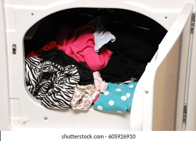 close up on dryer with clothes in and door open