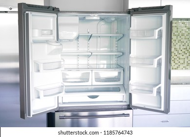 close up on empty refrigerator with door open