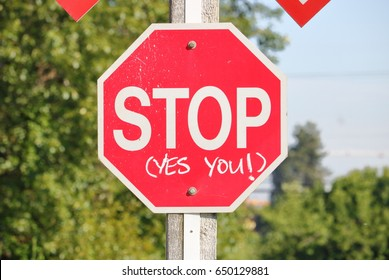 Close on an English stop sign imploring people to stop/Close on Emphatic Stop Sign/Close on an English stop sign imploring people to stop.