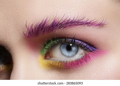 Close up on eyes , making colorful eyeshadows and eyeliner tutorial