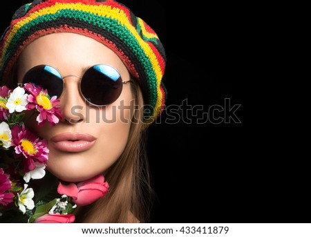 adb9065bfe Close up on face of beautiful young woman in hippie style with round  sunglasses