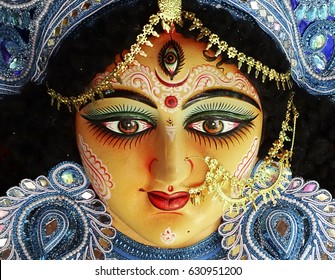 A close up on the face of an idol of Goddess Durga, symbol of strength and intensity as per Hinduism. This portrait was clicked before the Durga Puja celebrations at a potter's studio in Kolkata.