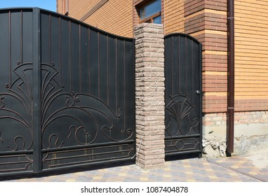 Close Up On Fence Door Installation And Metal Fence Gate.