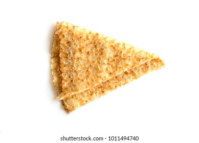 Close up on a folded crepe (french pancake) isolated on white background